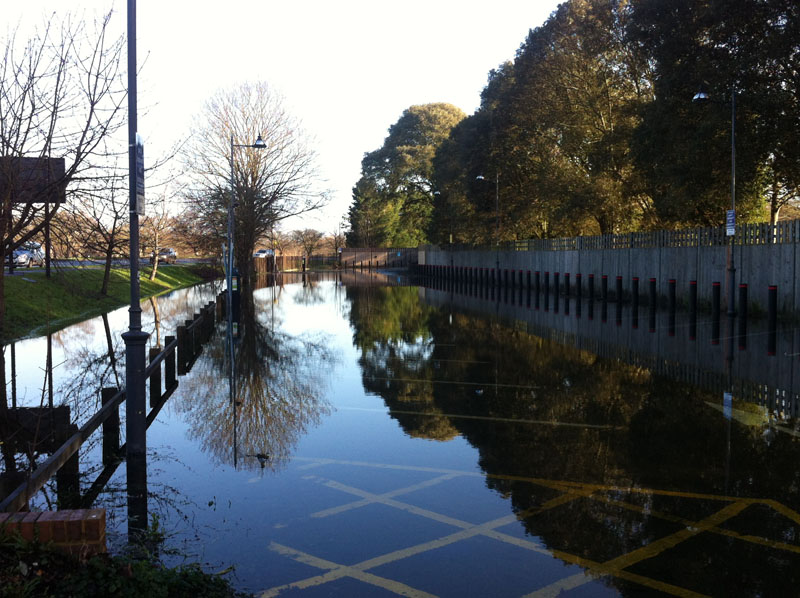 The Car Park At Far End Of Home Beyond Pavilions And Tennis Courts Is Still Closed As Access Road Flooded